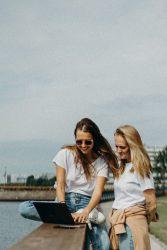 two-women-in-white-shirts-2773503